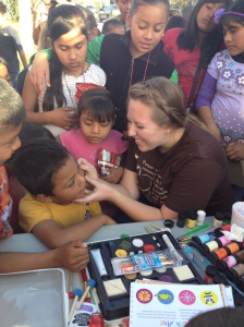 Meagan Dagnan face painting at a block party