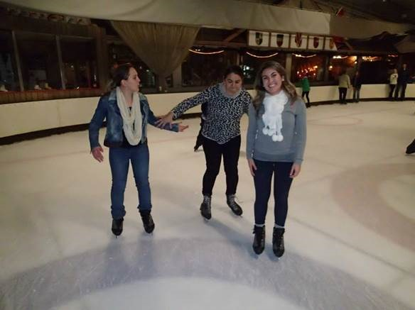Three international students ice skating at our women's event